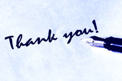 Thank you. Thank ou writing and fountain pen on white paper - in blue light Stock Photos
