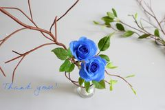Thank you background. With grateful message, two blue roses with green leaf from clay art on white background, card for teacher day, mother day or woman day Royalty Free Stock Photography