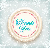 Thank you badge on winter snow background Royalty Free Stock Photography