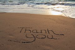 Thank you beach. Thank you written in the sand on the beach royalty free stock photo