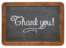Thank you on blackboard. Thank you - white chalk text  on a vintage slate blackboard isolated on white Royalty Free Stock Images