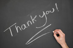 Thank You. Blackboard with Thank You wrote on it with a hand Royalty Free Stock Photos