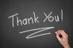 Thank You. Blackboard with Thank You wrote on it with a hand Royalty Free Stock Photography