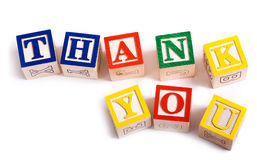 Thank You Blocks. A child's alphabet blocks on a white background spelling out the words 'thank you stock photo