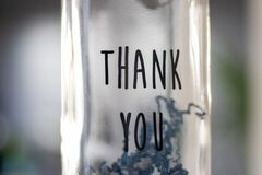 Thank you on a bottle focused in