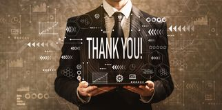 Thank you with businessman holding a tablet computer stock photography