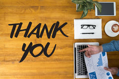 THANK YOU. Businessman working at office desk and using computer and objects, coffee, top view royalty free stock photo
