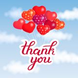 Thank you calligraphy hand lettering hanging with colorful balloon in blue sky with white clouds, vector art illustration royalty free illustration