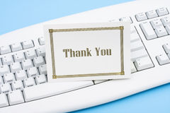 Thank You Card. On a white keyboard royalty free stock photos