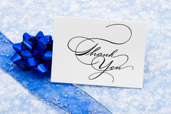 Thank You Card. With ribbon and bow on blue snowflake background Stock Image