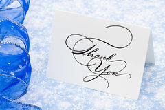 Thank You Card. With ribbon on blue snowflake background stock images