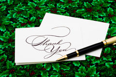 Thank You Card. And pen on leaf and holly berry background Royalty Free Stock Photo