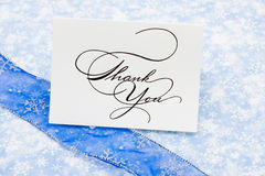 Thank You Card. With ribbon on blue snowflake background Royalty Free Stock Photo