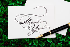Thank You Card. And pen on leaf and holly berry background Royalty Free Stock Photography
