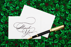 Thank You Card. And pen on leaf and holly berry background Royalty Free Stock Image
