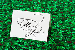 Thank You Card. On leaf and holly berry background Royalty Free Stock Images