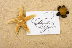 Thank You Card. A starfish and a turtle sitting on a thank you card with a sand background, turtle Royalty Free Stock Images