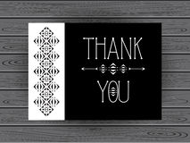 Thank you card in black and white with geometric ornament on wood texture. Royalty Free Stock Photos