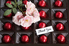 Thank You Card. With a Box of Pralines and Roses Royalty Free Stock Photos