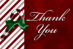 Thank You. A Thank You card, A Candy Cane with words Thank You over red plush background Stock Images