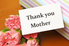 Thank you card with carnation and gift box Stock Images