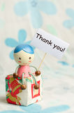 Thank you card. A doll and gift box with thank you card Stock Images