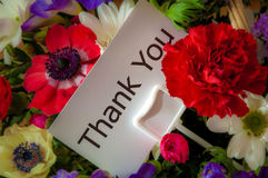 Thank You card in flowers. Close up of bouquet of flowers with message card: Thank You stock photos