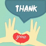 Thank you card 2. Hand pose as heart above word  you with word  thank  on navy blue banner on blue sky polka dot background Stock Image