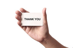 Thank You Card. In the hand of a woman in a white background Royalty Free Stock Photography