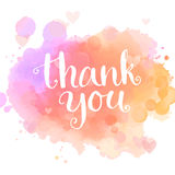 Thank you card. Handwritten white phrase on pink Stock Photo