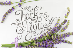 Thank you card with lavender flowers. On table Stock Photo