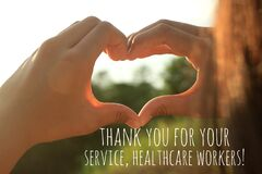 Thank you card and love message for healthcare workers for giving your life to serve us. With young woman making hands love sign.