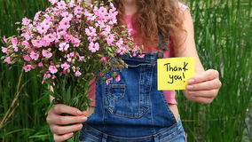 Thank you card and pink flowers bouquet. Beautiful woman with Thank you card and pink flowers bouquet stock footage