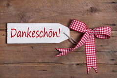 Thank you card with a red checkered ribbon on old wooden board Stock Photo