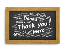 Thank You Chalkboard Concept. International thank you text in different languages for thanksgiving concept on a wooden blackboard or chalkboard on white Royalty Free Stock Image