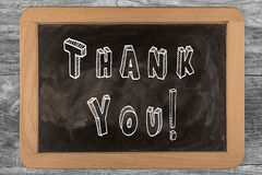 Thank You! - chalkboard with outlined text. On wood Stock Photo