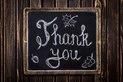 Thank you on chalkboard Stock Images