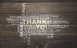Thank you cloud on wood. Thank you, thanks in different languages, word cloud on vintage rustic wood planks floor Stock Image