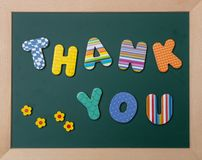 Colorful letters shaping the word thank you on green board with wooden frame. Thank you, Colorful letters shaping the word thank you on green board with wooden royalty free stock images