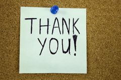 Thank you - colorful sticky notes with handwriting on cork bulletin board. Businnes concept stock images