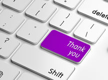 Thank you. A computer keyboard with word thank you text on purple key, replacing the enter key Royalty Free Stock Photo