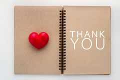 Thank you concept with Blank open notebook and red heart.jpg. Thank you concept with Blank open notebook and red heart and copy space for your text Royalty Free Stock Photos