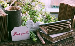 Thank you concept, kraft paper notebook, writing message on piece of paper