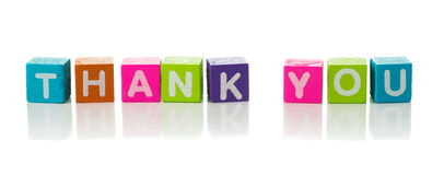 Thank you. Cubes each with a letter on it written the word thank you Royalty Free Stock Image
