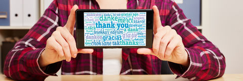 Thank you in different languages on a smartphone. 's touchscreen Stock Photography