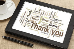 Thank you in different languages. Word cloud on a  digital tablet Stock Photos