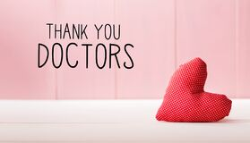 Thank You Doctors message with a red heart cushion