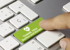 Thank you doctors and nurses - Inscription on Green Keyboard Key