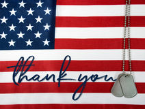Thank you and dog tags on flag