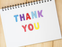 Thank you 21. Font Thank you on blank notebook with wood background royalty free stock image